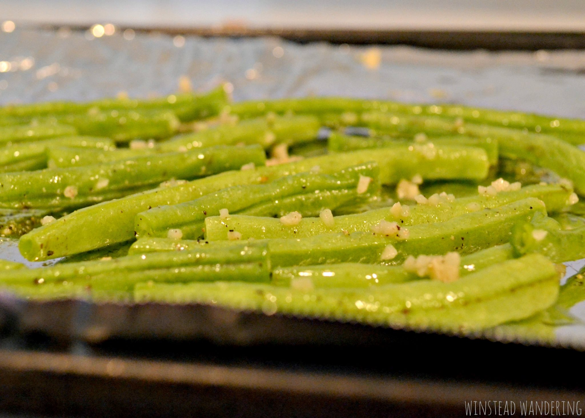 These baked garlic green beans are easy, healthy, and delicious. The best part? They only use a few ingredients and you don't have to dirty any pans or bowls to make them.