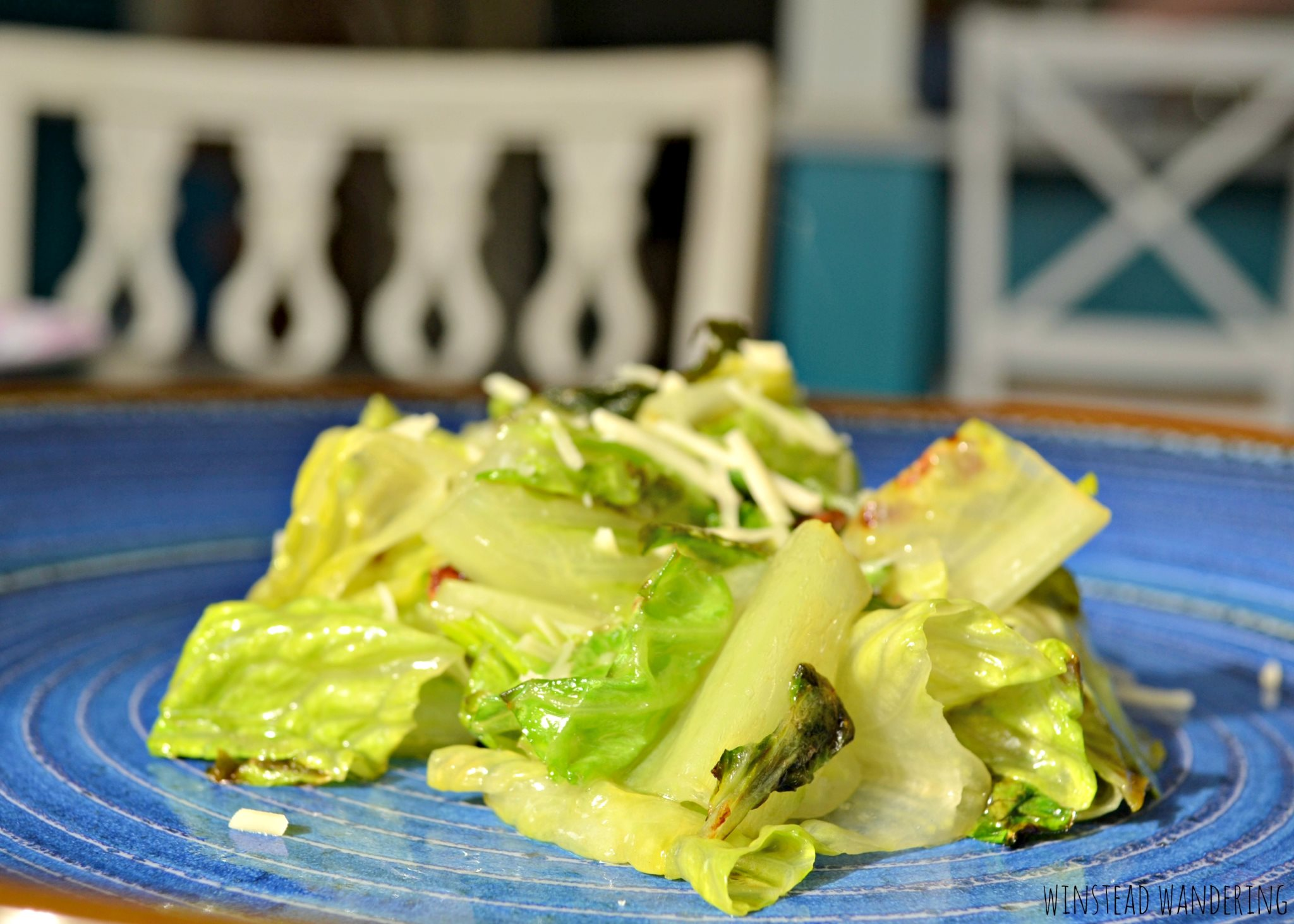 Pan-fried romaine lettuce is a fun and unique spin a boring salad. It's just as fast as gathering all the ingredients for a good salad, but it tastes so much better.