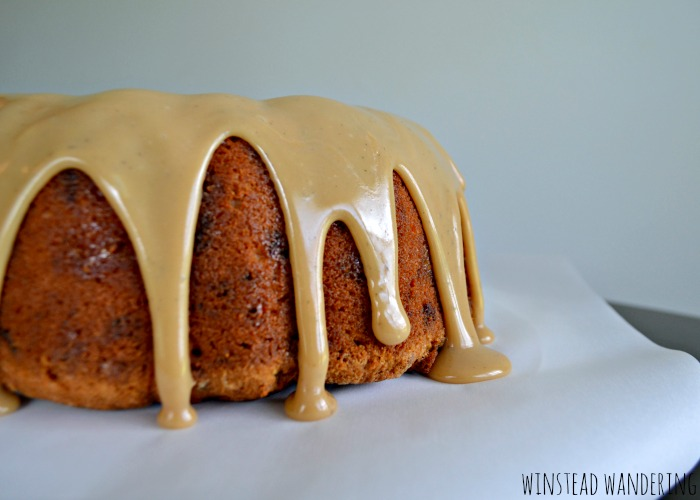 Brown sugar pound cake with caramel icing is a rich, moist cake, flecked with toffee bits and smothered in an easy, decadent caramel sauce.