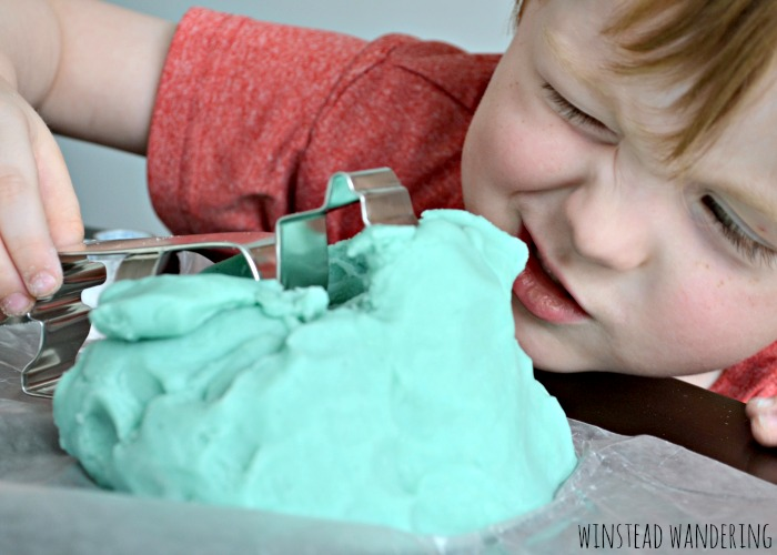 Adding a packet of Kool-Aid to homemade playdough is a simple way to give your batch a vibrant color and a fun, fruity smell.