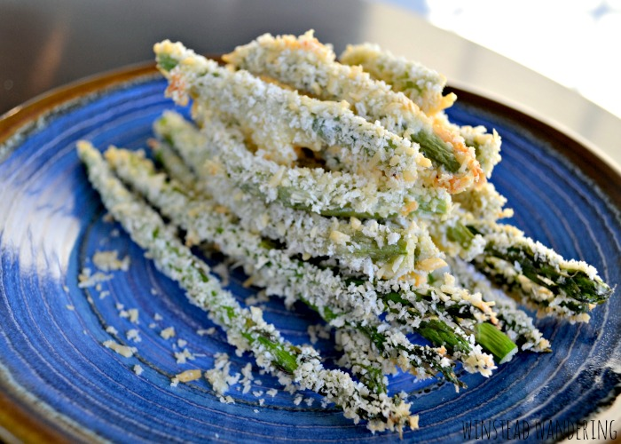 Green beans and asparagus are coated in crispy bread crumbs and Parmesan cheese and baked until tender for a healthy side dish with a satisfying crunch.