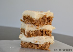 A boxed cake mix is elevated with heaps of cinnamon, baked until chewy, and spread with a thick layer of icing for cinnamon roll bars with cream cheese frosting.
