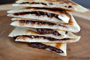 Warm and gooey chocolate chip cream cheese dessert quesadillas are the perfect rich, indulgent way to end your day.