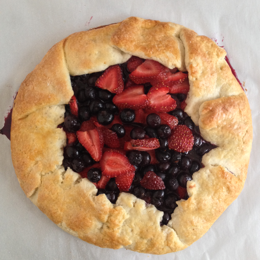 This summer berry crostata is a rustic homemade dough packed with juicy strawberries, plump blueberries, and the perfect complement of spices.