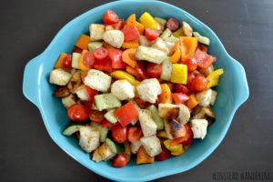 Colorful fresh veggies, tossed with vinaigrette and crispy homemade croutons, make up this warm and hearty Greek Panzanella.
