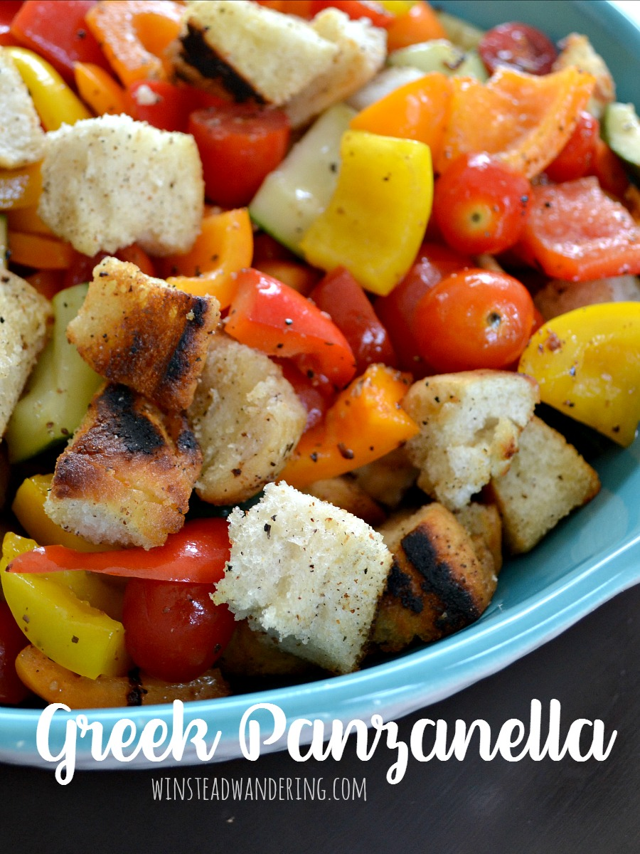 Colorful fresh veggies, tossed with vinaigrette and crispy homemade croutons, make this warm and hearty Greek Panzanella the perfect appetizer, salad, or meal.