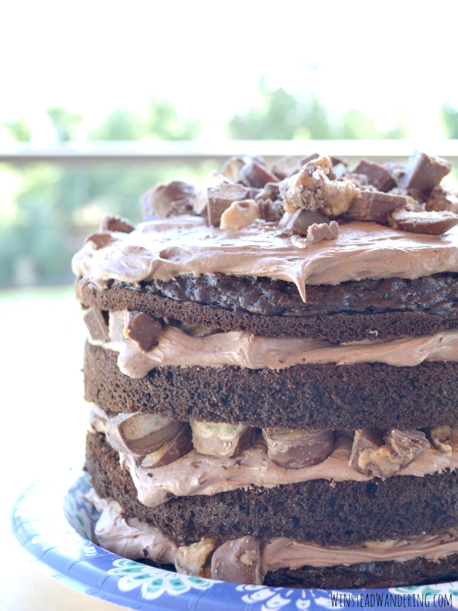 Loaded Candy Bar Cake with Cream Cheese Frosting, with homemade frosting and candy bars in every bite, is every chocolate lover's decadent dream come true.