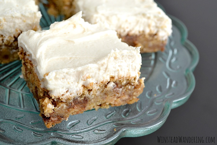 Skip the bore and the time suck of rolling individual cookies and make these chewy and decadent toffee-studded Frosted Heath Cookie Bars instead.