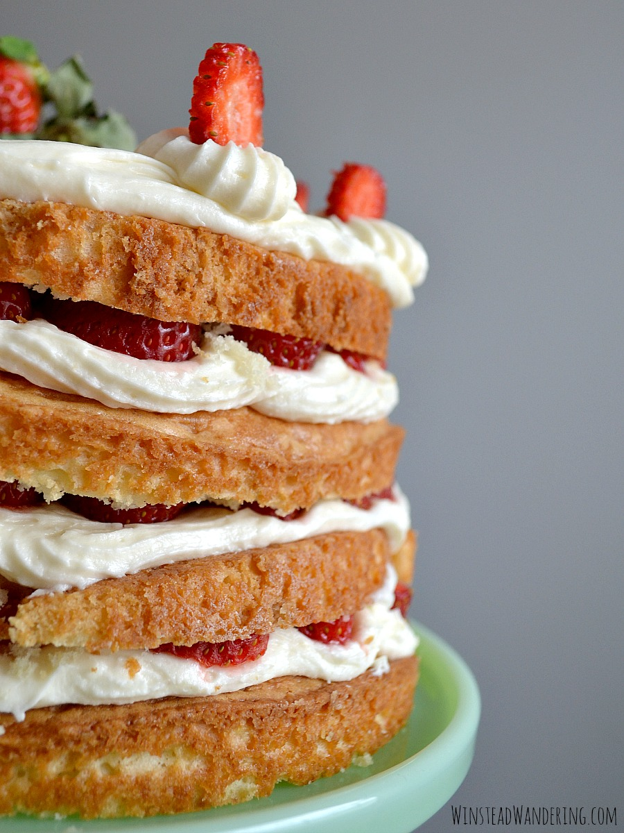 This Strawberries and Cream Layer Cake combines three dessert favorites -  moist vanilla cake, fluffy cream cheese frosting, and tart strawberries - into one mouthwateringly decadent dessert.